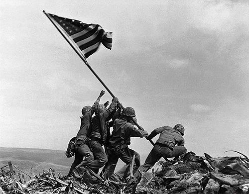 Raising the flag on Iwo Jima by Joe Rosenthal